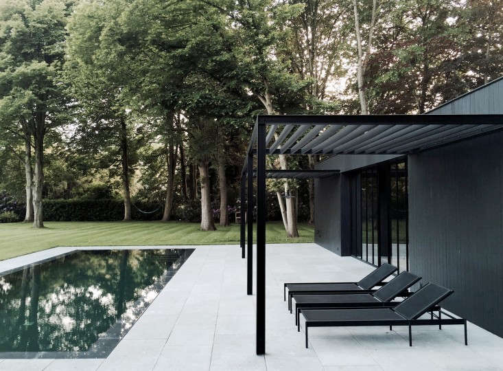 """A dark, spare pool house reflects the design philosophy of Belgian master architect Marc Merkx: """"a constant search for the perfect balance between proportions, materials, and space."""" Photograph courtesy of Marc Merckx."""