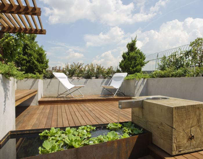 """""""We designed this project to weather well,"""" says designer Jon Handley of Pulltab Design. Over time, the ipe decking will turn gray, the Corten steel water basin will continue to rust, and the oak block will blacken. Photograph by Bilyana Dimitrova."""