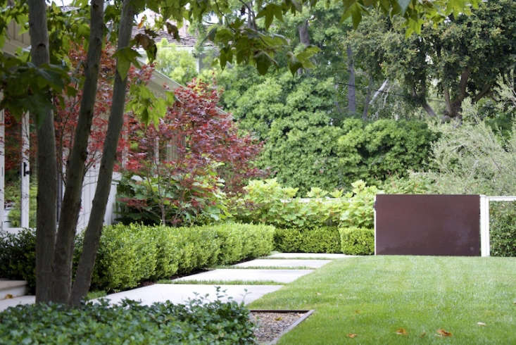 "In a Pacific Palisades, California landscape, Grow Outdoor Design used a combination of sliding wood gate, Cor-ten steel panel, and jasmine-covered hog-wire fencing, which ""all harmonize to create privacy,"" according to firm partner Joel Lichtenwalter."