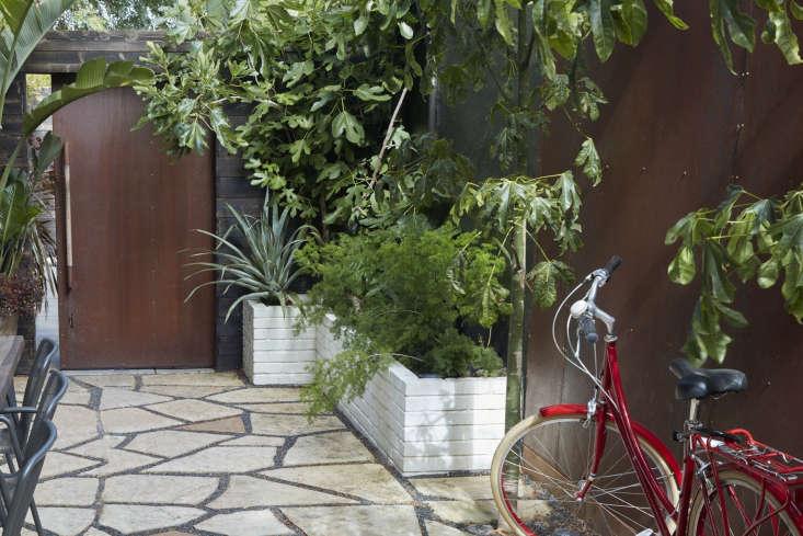 Cor-ten steel panels create a privacy fence in a small San Francisco garden by designer Daniel Nolan. Photograph by Caitlin Atkinson.