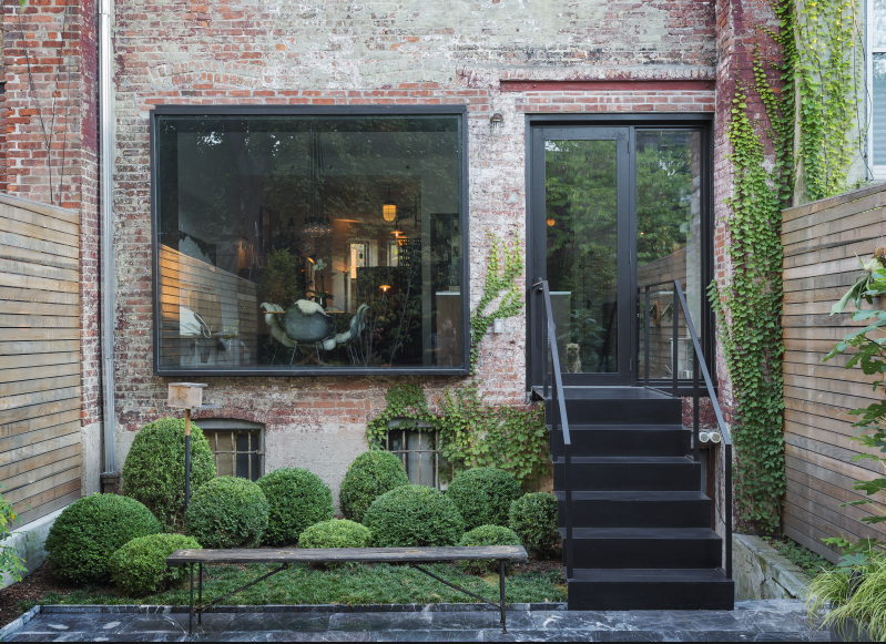 A high-low mix of luxury and restraint (andclipped boxwood balls) lend a European air to Kristin Meidell's Brooklyn courtyard garden. Photograph by Matthew Williams for Gardenista. For more of this garden, see our bookGardenista: The Definitive Guide to Stylish Outdoor Spaces.