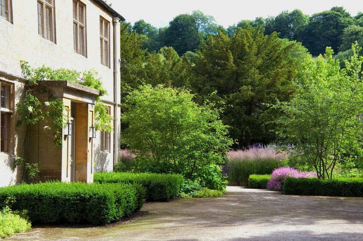 A loose topiary look can also work, as shown by the slightly shaggy boxwood hedges atDan Pearson's Old Rectory, in the heart of a Cotswolds village. Photograph by Nicola Browne and Dan Pearson Studio.
