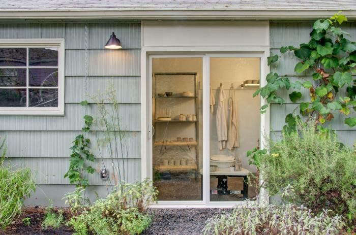 A Portland, Oregon couple converted a garage into three distinct parts: a ceramics studio, a storage room for bikes, and a wood shop. The ceramics studio, shown through the sliding glass doors above, is partitioned from the rest of the space to be free of dust from the wood shop. Read the whole story in Rehab Diaries: A Garage Turned Studio Workshop in Portland, OR.