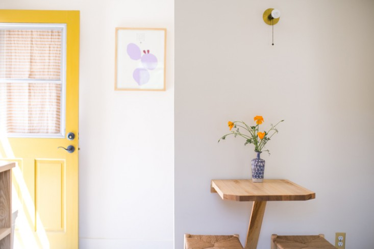 Fan dissects how to get the look of this Cheerful Kitchen in Echo Park—spray of poppies atop a wall-mounted breakfast perch included.