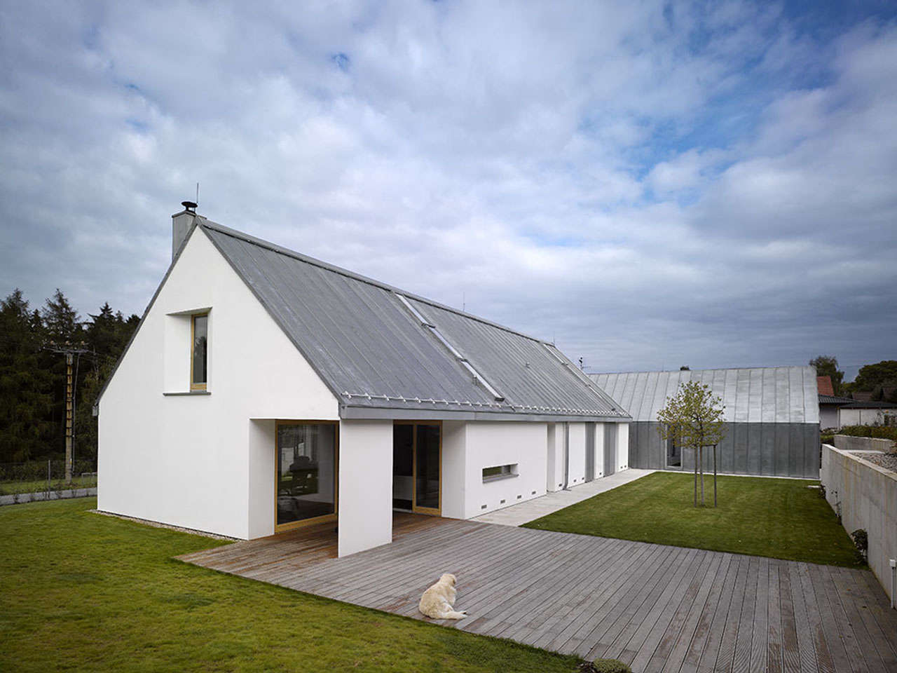 Prague-based Studio Pha designedtwo barn-like structures for afamily compound, connected by grade-level decking.Photograph by Filip Slapal, from Architect Visit: Barn-Like Living, Only Better.