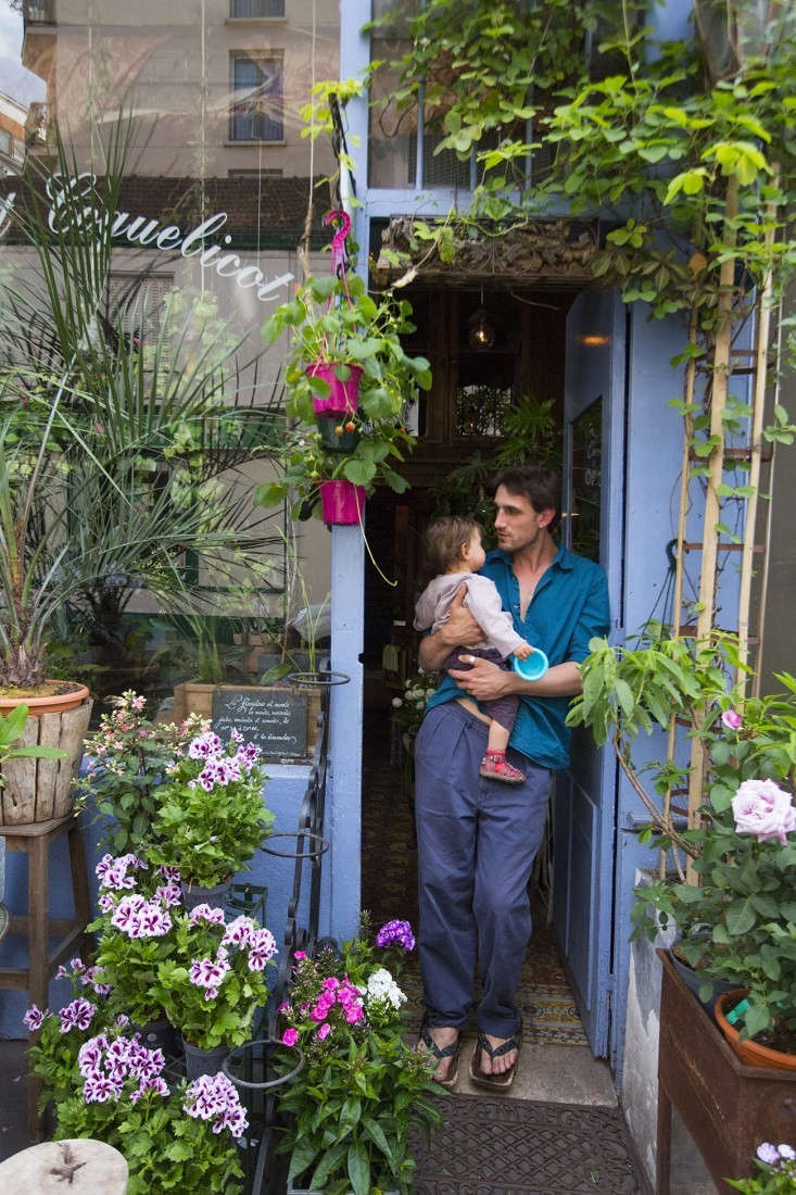 """Tom des Fleurs, the fleurist at Bleuet Coquelicot near Paris's Canal St. Martin, painted his storefront in a bright pastel shade of lavender-blue (his store name after all means """"blue poppy""""): No. 6 French Lavender from Designers Guild. Photography by Mimi Giboin fromShopper's Diary: Bleuet Coquelicot in Paris."""