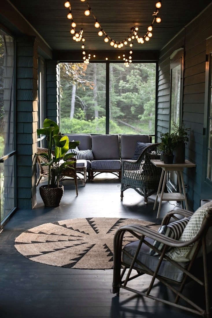 Design team Tara Mangini and Percy Bright of Jersey Ice Cream Co. rescued a nondescript and unloved screened porch in the Catskills–and made it magical. Photograph courtesy of Jersey Ice Cream Co., from Before & After: A Summer Porch Rehab in Upstate New York.