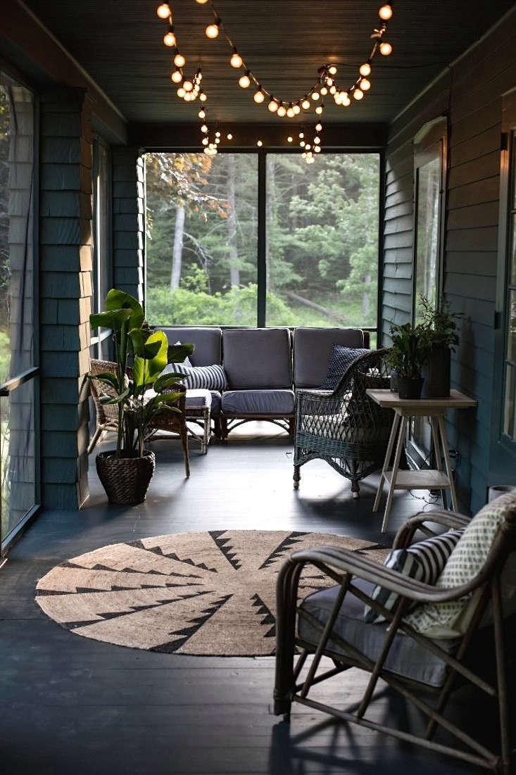 Design team Tara Mangini and Percy Bright of Jersey Ice Cream Co.rescued a nondescript and unloved screened porch in the Catskills–and made it magical. Photograph courtesy of Jersey Ice Cream Co., from Before & After: A Summer Porch Rehab in Upstate New York.