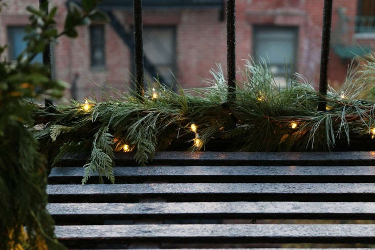 The fire escape, dressed for winter. Photograph by Erin Boyle from DIY: A Holiday Fire Escape.