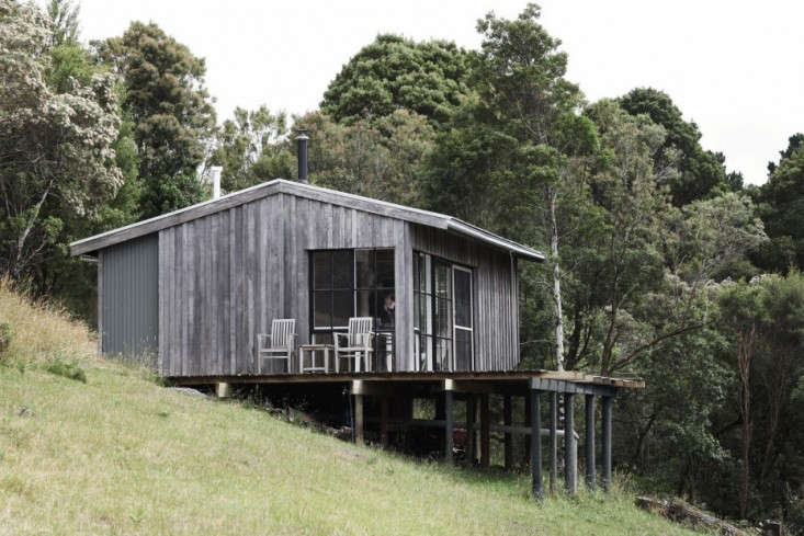 Phoebe Dann, a Melbourne-based graphic designer, transformed a derelict shed (with her architect/product designer husband, Anthony Dann) into a compact, off-the-grid retreat, just big enough for the two of them and their baby daughter, Fleur. Photograph by Astrid Salomon fromOff-the-Grid Retreat: A Homemade Cabin in Australia.