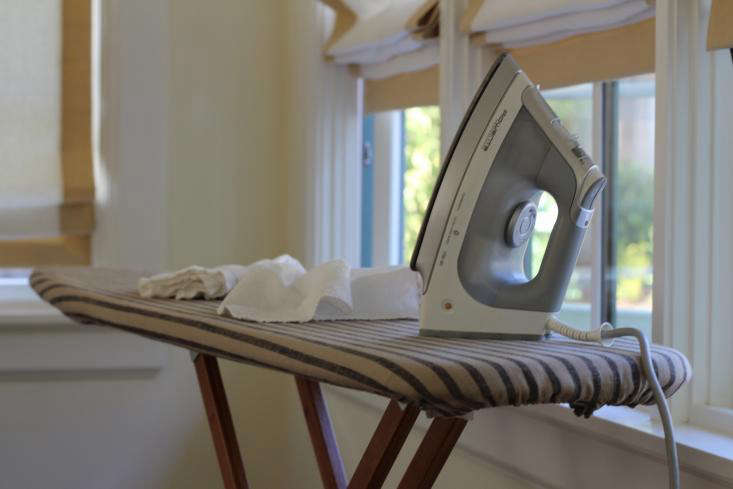 I iron a lot. And I hate to lug around my ironing board, so I often leave it standing by the window where I iron. I have always wanted an ironing board that miraculously folds down from a wall or pops out from a drawer or wall like a magic trick.