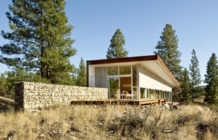 Outside a house in Winthrop, Washington, by David Coleman Architecture, gabion acts as a retaining wall, a privacy screen, and a contextual link between building and landscape. Construction waste was dramatically reduced by using excavated material as filler. Photograph by Lara Swimmer, courtesy of David Coleman Architecture.