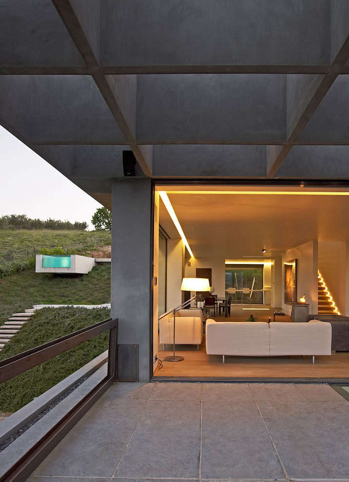 Workshop Dionisis + Kirki took advantage of the landscape when designing this home in the south of Greece