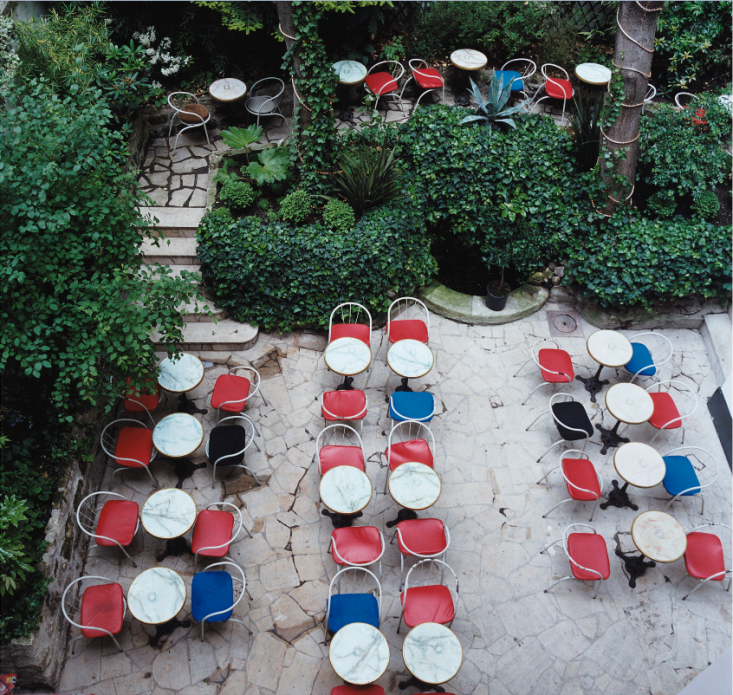 Blue, white, and red cafe chairs make for a summer-ready Parisian patio inEscape to Love: Hotel Amour in Paris, from the Remodelista archives.