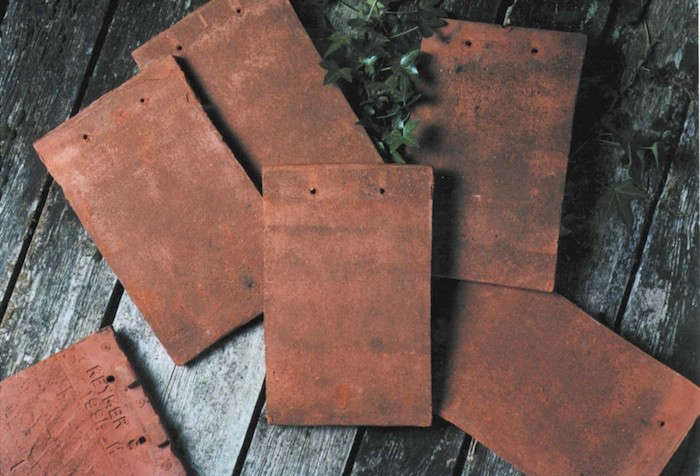 The UK has several companies that produce handmade tiles.Keymer, for instance, makes the traditional tiles shown here, and has a US distributor.