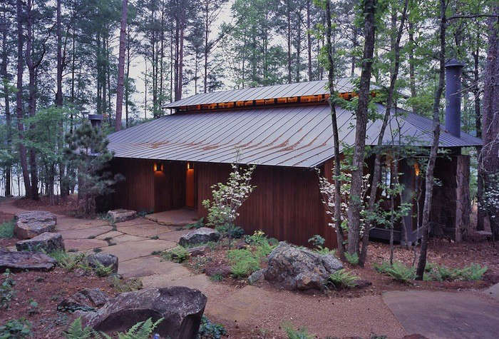 San Antonio-based Lake Flato Architects often uses standing seam metal roofs (as pictured in this Pine Ridge cabin) because they&#8