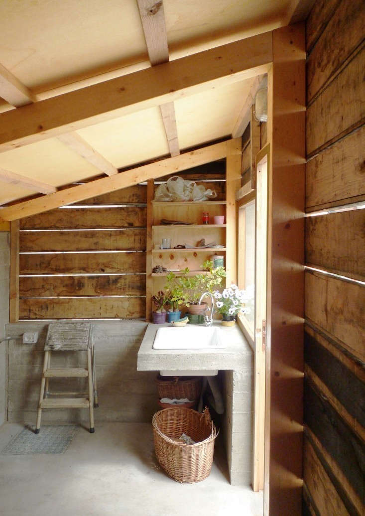 bove: A potting shed in northwestern Italy that once stored only firewood is now outfitted with a sink, shelving, and a sunny window. For the rehab story, see Outbuilding of the Week: A Woodshed Transformed, by StudioErrante in Italy. Photograph by StudioErrante Architetture.