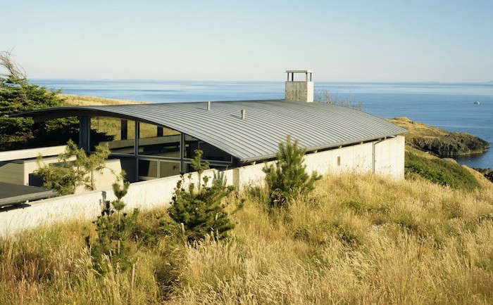 Seattle-based architects Suyama Peterson Deguchi topped this San Juan Island retreat with a vaulted zinc standing seam roof shell. Image by Paul Warchol.