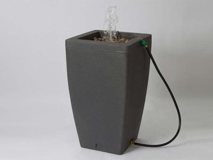 One-stop shopping. A freestanding, 49-gallon Fountain Rain Barrel has flat sides so it can be placed against a wall; $5.8loading=