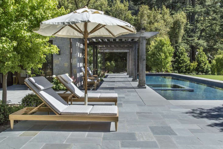 A pool surround, laid in an ashlar pattern, in Marin County, California; designed byKen Linsteadt Architects.