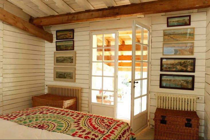 French doors connect a bedroom to the covered porch.