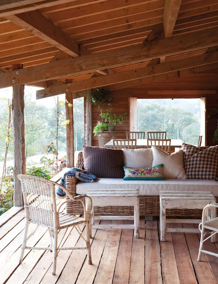 A covered porch does double-duty as an open-air outdoor dining room.