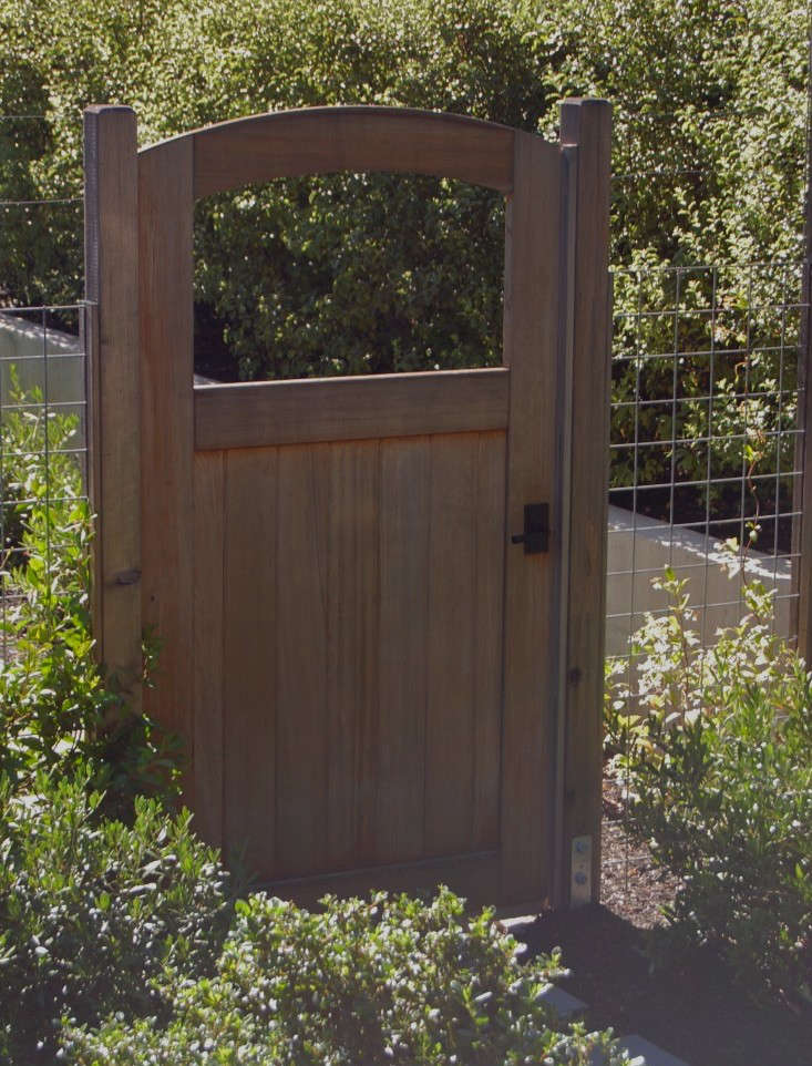 hog wire fence and garden gate