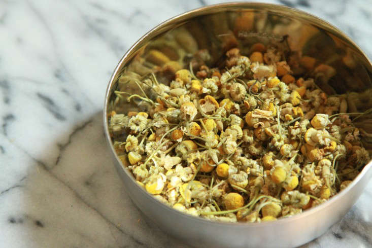 Dried chamomile flowers are used for making a floral-scented simple syrup that sweetens the tea.