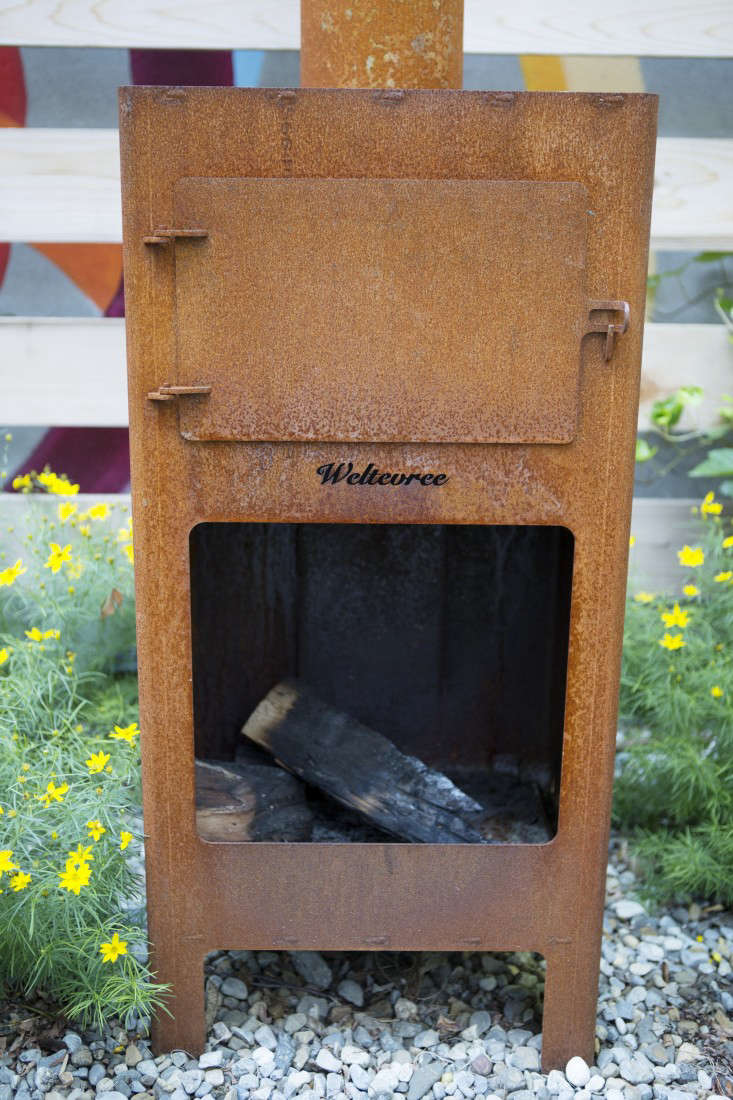 A request for a &#8\2\20;fire feature&#8\2\2\1; resulted in this wood-burningstove from the Dutch companyWeltevree; the stove is rusting beautifully in place. Open the door and slide in a pizza to bake.