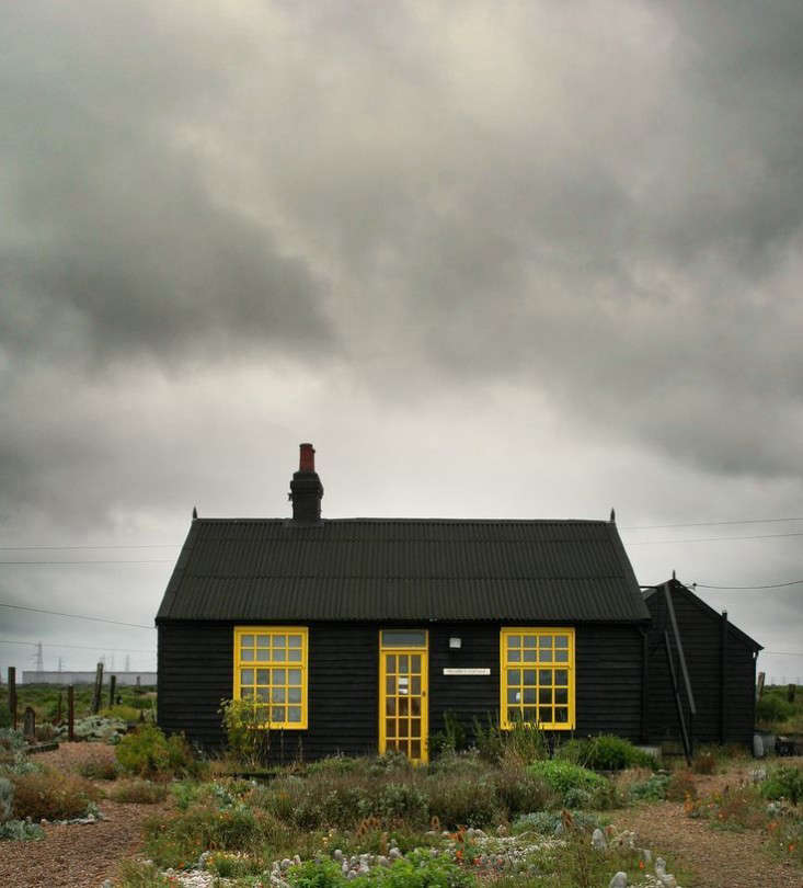 Derek Jarman black houses yellow trim cottage