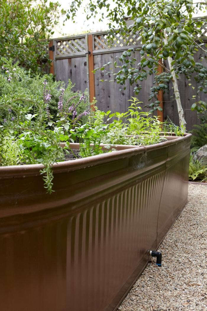 An irrigation hose is attached through the trough's drainage hole. For step-by-step instructions, see Steal This Look: Water Troughs as Raised Beds. Photograph by Marla Aufmuth for Gardenista.