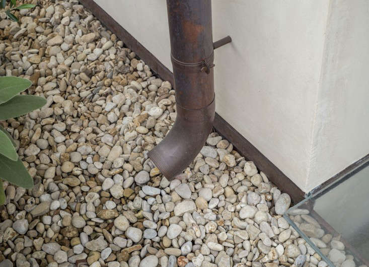 A gutter drains into a French drain in Texas.