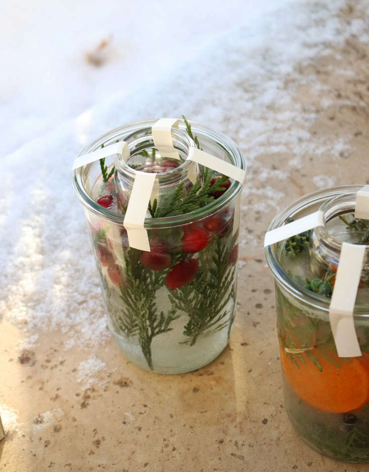 After they froze, I removed the tape and ran the jars under lukewarm water to loosen them. They slid right out.