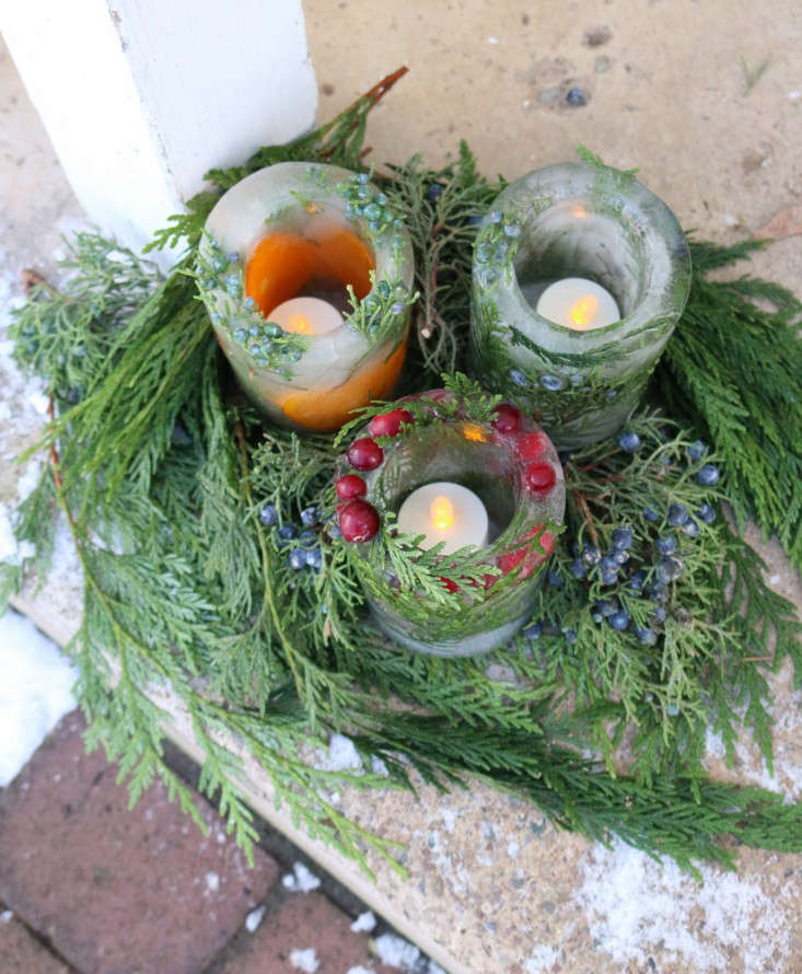 To preserve the life of the ice lanterns and to alleviate any worry of the greenery catching fire, I used flameless outdoor tea lights. The tea lights technically aren&#8