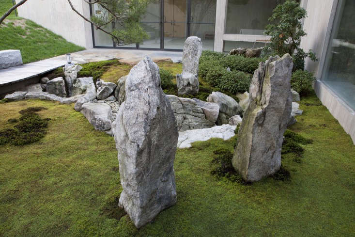 Handpicked stones have a human-like quality and symbolize the three men in the ancient Chinese parable that inspired the garden.