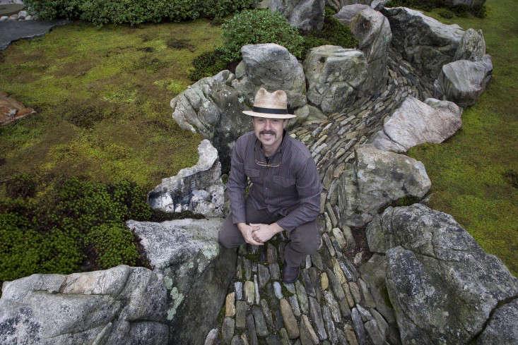Garden designer Marc P. Keane in the dry river he created at Tiger Glen Garden.