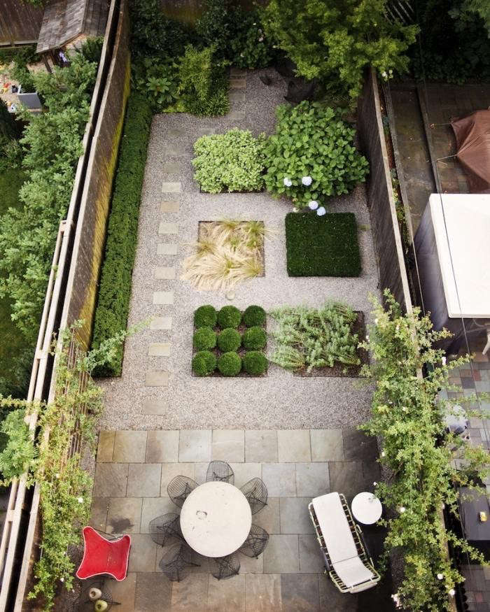 Make a long, narrow space feel wider by unifying all the elements with a pea gravel border. Photograph courtesy of Foras Studio, from Steal This Look: Modern Brooklyn Backyard on a Budget.