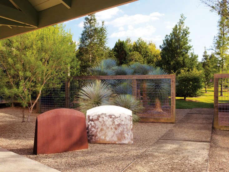 A courtyard paved in pea gravel and flagstone; Texas artist John Walker&#8