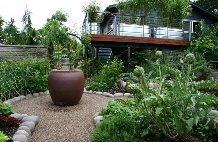 rehab-diary-eugene-oregon-garden-sone-wall-galvanized-trough-planters-stone-edging-pea-gravel-gardenista
