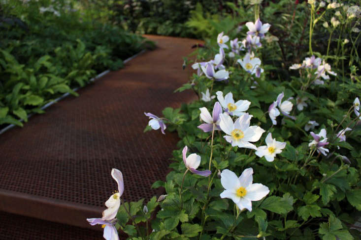 A rusted iron walkway by Hugo Bugg at the Chelsea Flower Show in London. See more in Expert Advice: \10 White Garden Ideas from Petersham Nurseries. Photograph by Kendra Wilson.