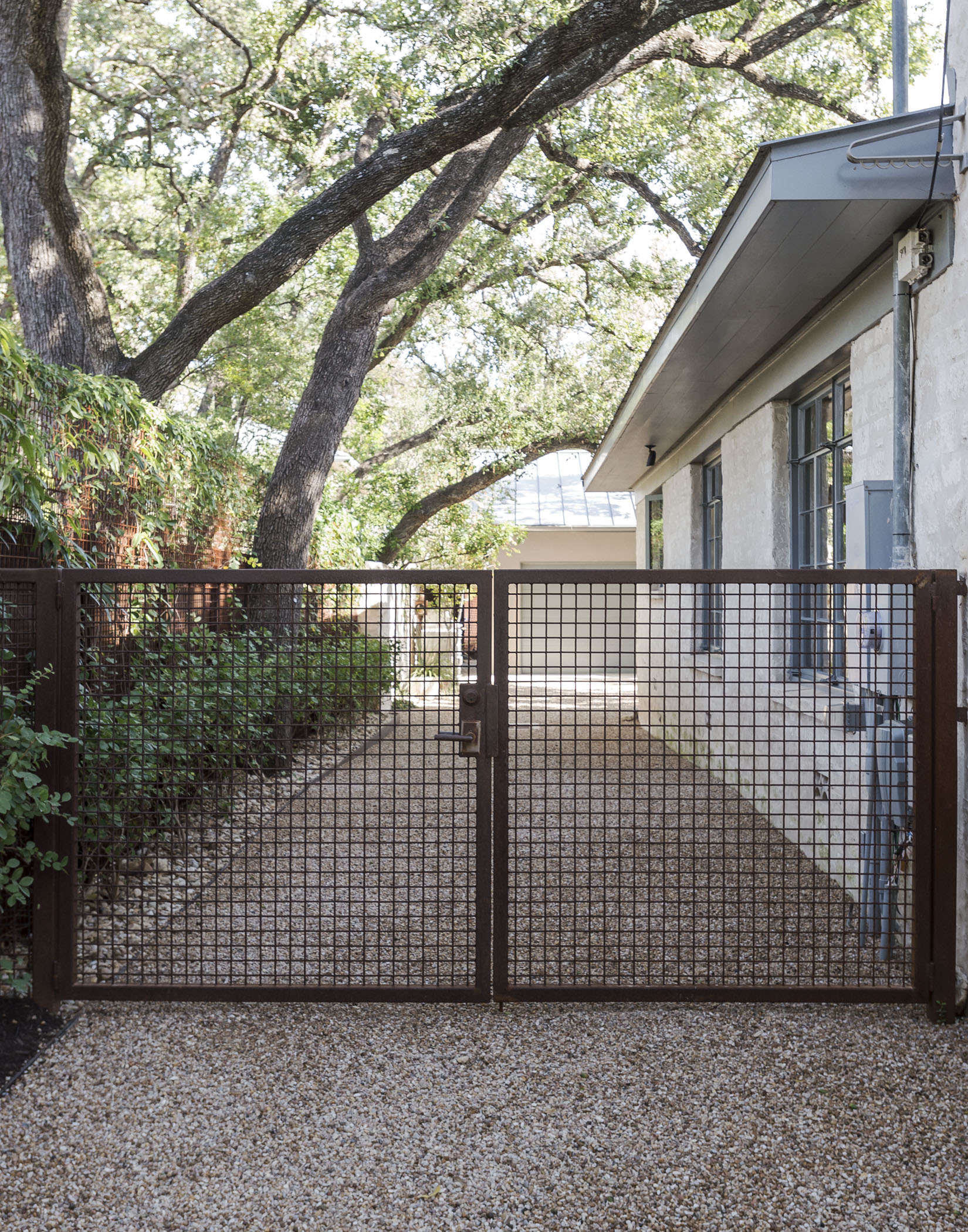 A rusted gate on the side of landscape architectChristine Ten Eyck&#8\2\16;s own house in Austin, Texas. Photograph by Matthew Williams for Gardenista.