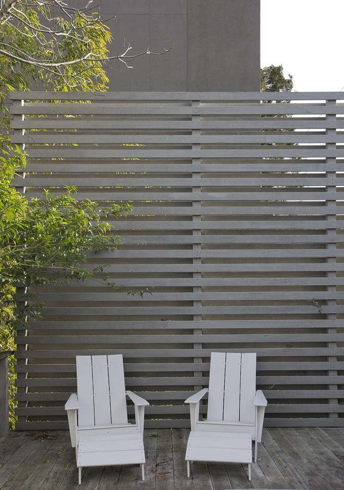 Widely spaced slats in a tall wood fence shades a deck at the San Francisco home ofgraphic designer Jennifer Morla (of Morla Design) and her architect husband, Nilus de Matran (of Nilus Designs). For more, see At Home with an SF Design Duo on Remodelista. Photograph by Mimi Giboin.