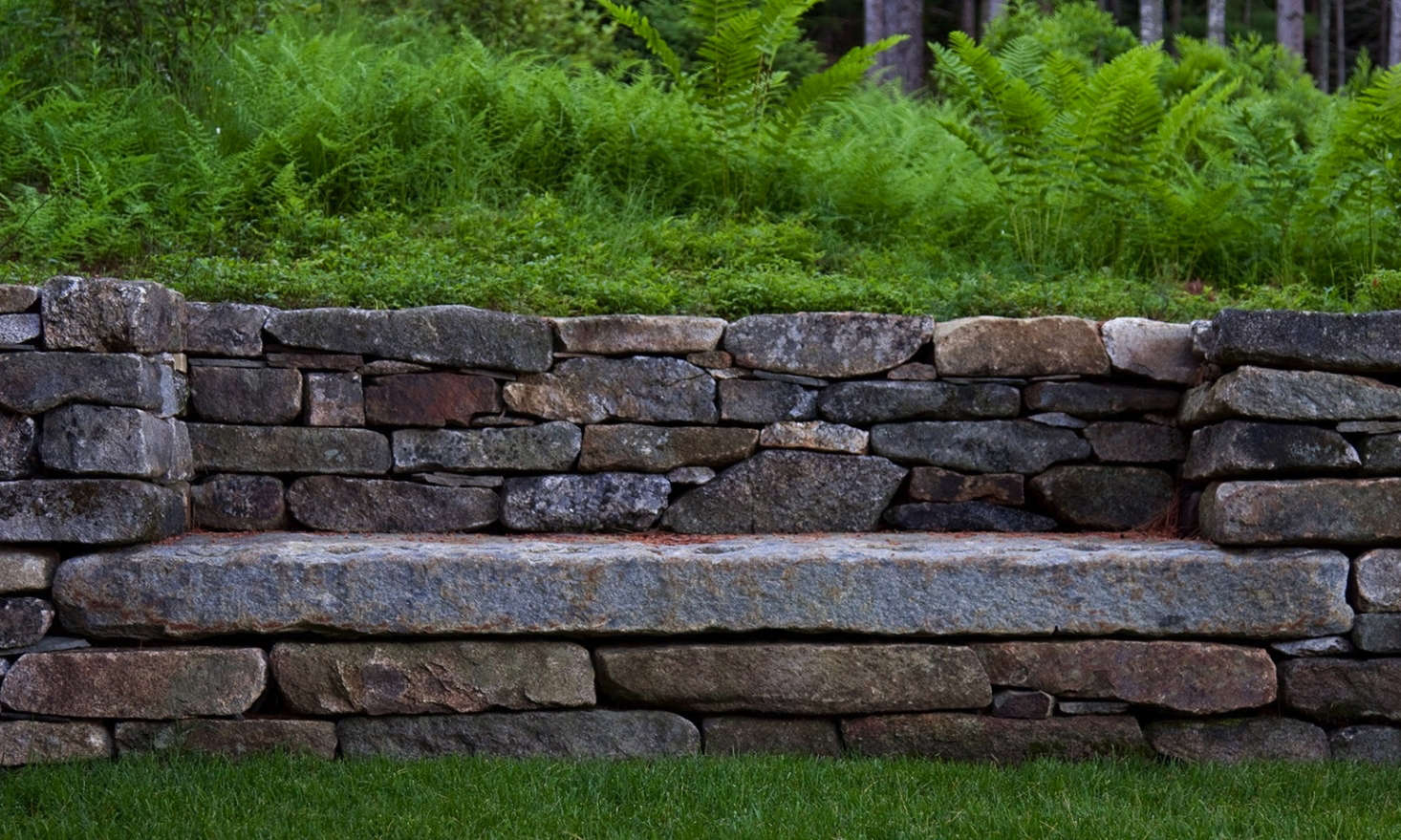 Granite retaining walls direct water flow away from the house and minimize runoff.