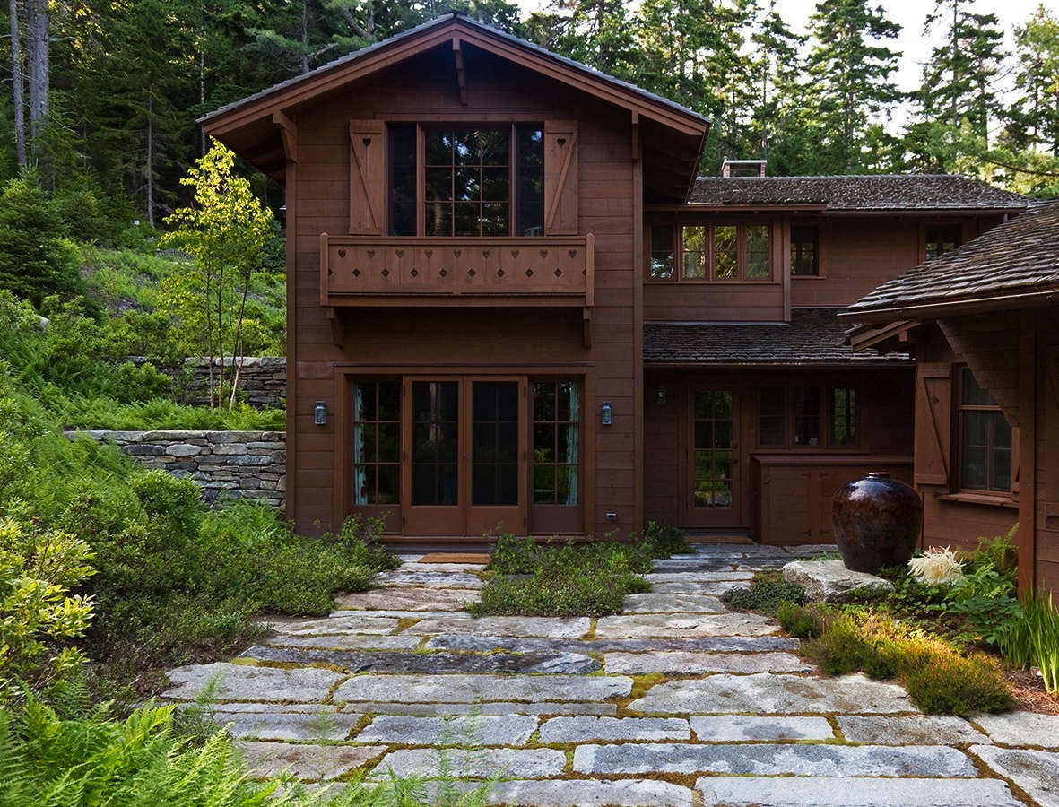 Built in , the main house resembles a Swiss chalet. Retaining walls of dry-laid fieldstone and paths of local granite are new storm-proofing features, to aid drainage and prevent erosion.