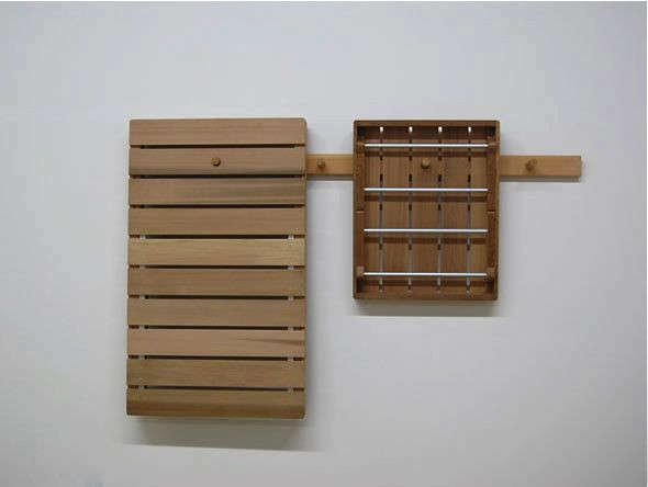 &#8\2\20;We have worked off of the theme of the shaker peg rail on a few projects, and we liked the idea that you could hang up your garden furniture when not in use or during the off season, and that it would look equally as nice stored as in use,&#8\2\2\1; says John.