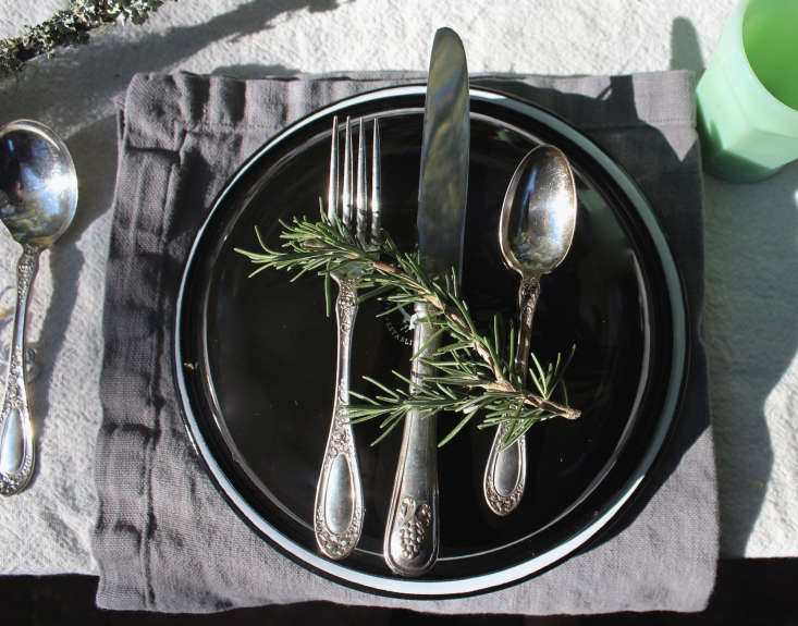 A sprig of rosemary makes for an artful and fragrant place-setting topper. Photograph by Michelle Slatalla, from DIY: Thanksgiving Outdoors.