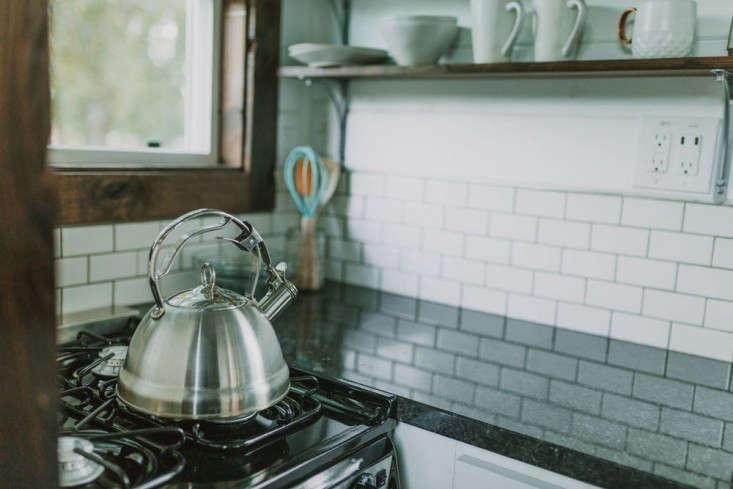 tiny-house-on-wheels-kitchen-stove-tile-kettle-gardenista