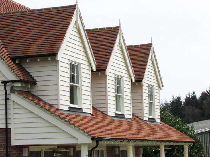 An example of traditional flat clay tiles on a wood-sided house. Photograph courtesy of Traditional Clay Roof Tiles of Kent, UK.