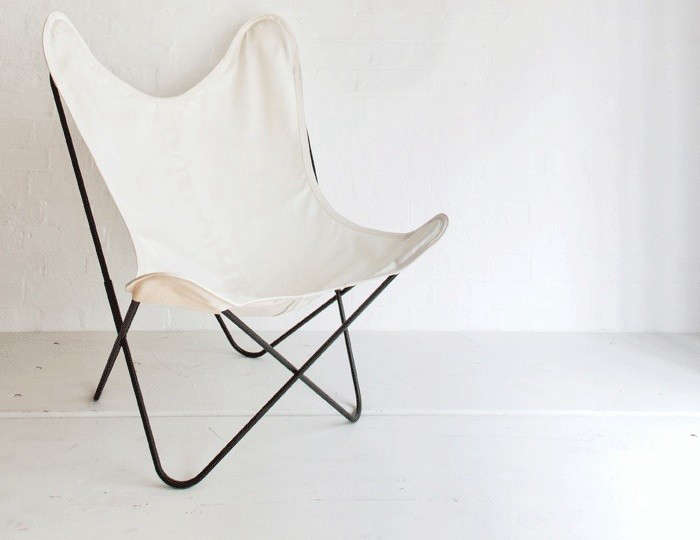 The classic French AA Butterfly Chair with black powder-coated metal frame and white canvas cover is £450 from Made in Design in the UK. In the US, Circa 50 offers a black powder-coated metal Butterfly Chair with white canvas cover for $400 (minimum order of
