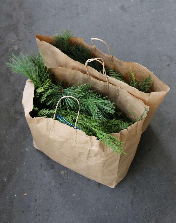 winter-fire-escape-1-garland-roping-evergreen-gardenista